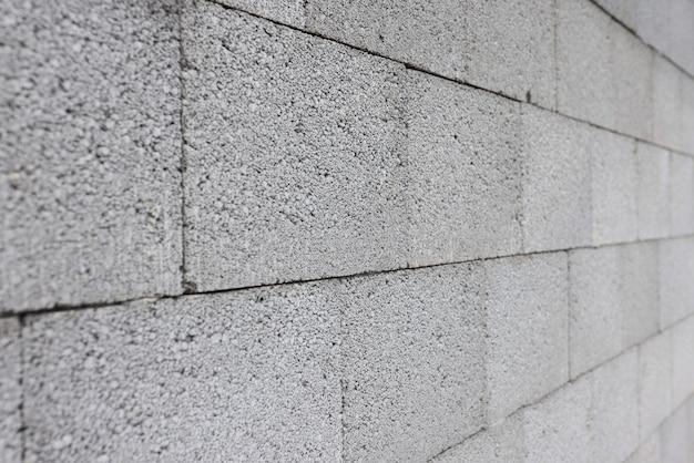 Muro di cemento grigio fatto di concetto di costruzione di blocchi rettangolari