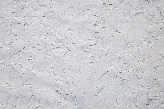 Struttura grigia del muro di cemento. muro di cemento grunge, materiale. modello moderno per il design decorativo. sfondo grigio. elementi interni ed esterni. sfondo astratto. pavimento grezzo irregolare in cemento.
