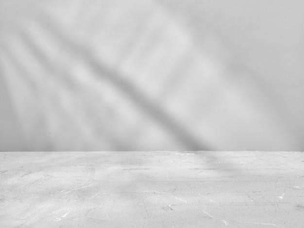 Sfondo grigio mock-up per la presentazione del prodotto con luce della finestra