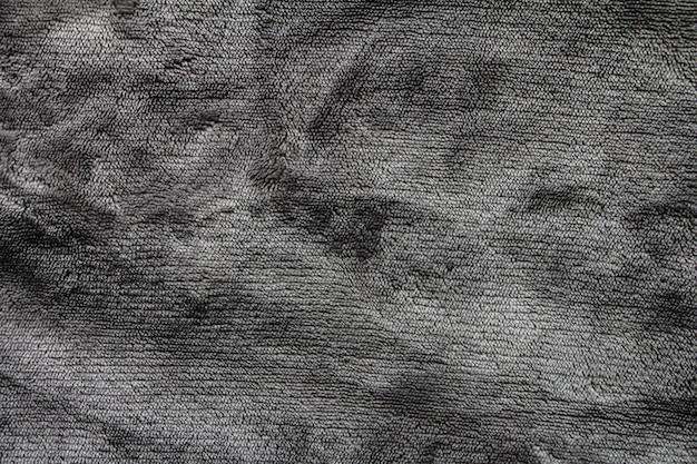 Grey shaggy coperta trama come sfondo fluffy finta pelliccia tessile soft focus messa a fuoco selettiva