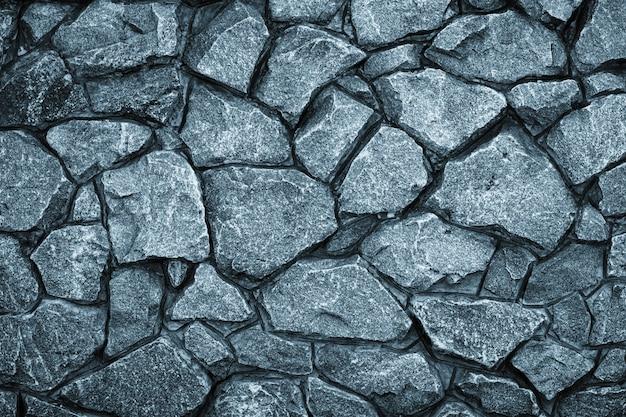 Sfondo grigio muro di pietra. mosaico di mattoni in stile retrò.