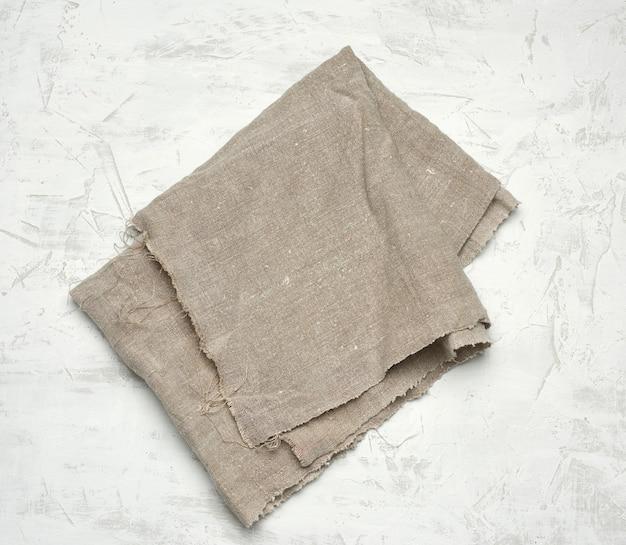 Asciugamano da cucina in tessuto grigio su bianco