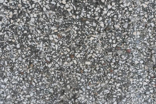 Il muro grigio di trucioli di granito texture di sfondo