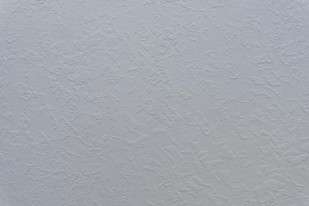 Struttura decorativa di struttura dell'intonaco della parete grigia di una foto di alta qualità della parete vuota