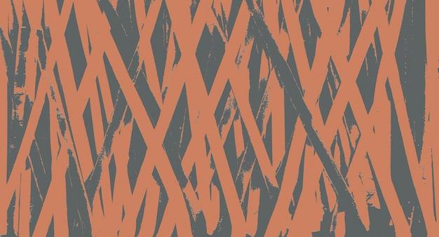 Muro grigio con vernice arancione sbiadita come sfondo.