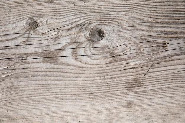 Struttura di legno grigio con crepe