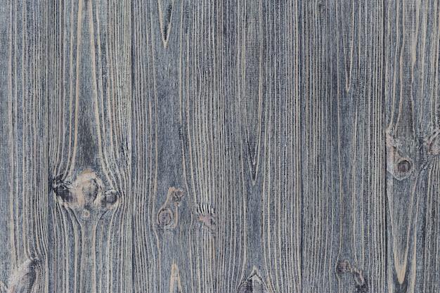 Struttura del tavolo squallido in legno grigio. sfondo di assi di pino.