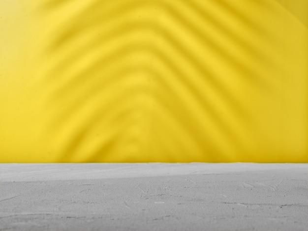 Sfondo grigio-giallo con ombre naturali