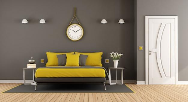 Camera matrimoniale moderna grigia e gialla