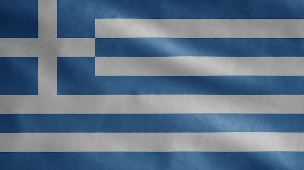 Bandiera greca che fluttua nel vento. chiuda in su della bandiera della grecia che soffia, seta morbida e liscia