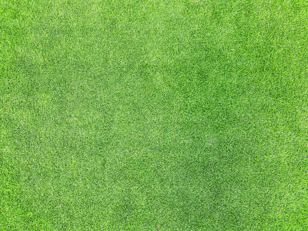Texture di pavimentazione in tappeto erboso artificiale verde per lo sfondo