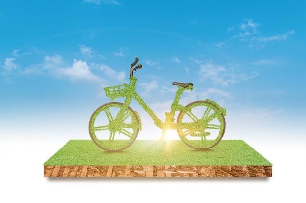 Bicicletta verde che guida campo di erba verde sopra il cielo blu. ambiente ed ecologia concetto