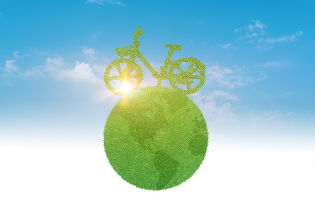 Bicicletta verde che guida con il pianeta sopra il cielo blu. ambiente ed ecologia concetto