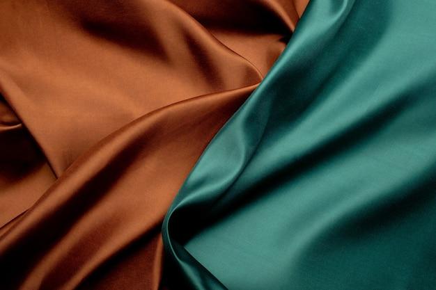 Priorità bassa di struttura del tessuto verde e marrone