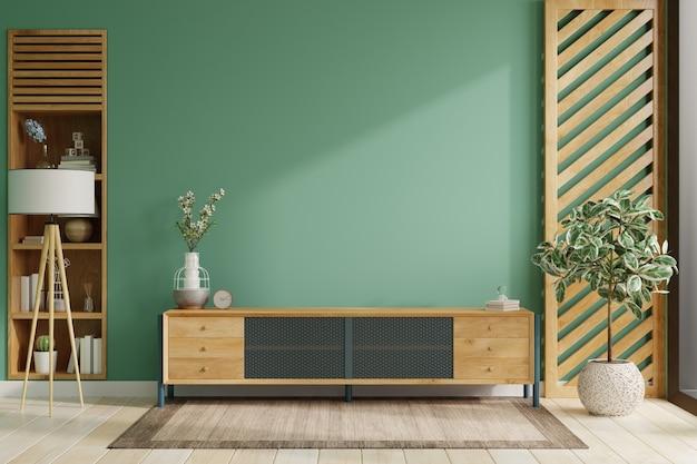 Su uno sfondo di parete di colore verde, un arredamento moderno del soggiorno con un mobile tv. rendering 3d