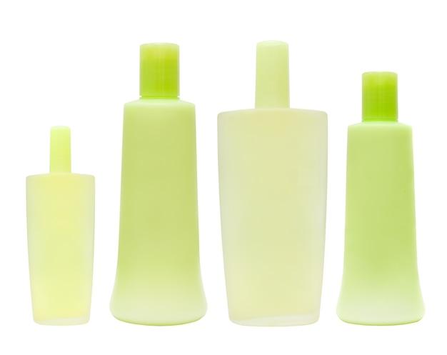 Bottiglia cosmetica verde - gruppo pulito isolato