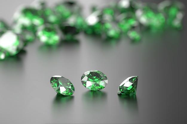 Gruppo di diamanti verdi su superficie lucida soft focus 3d illustration