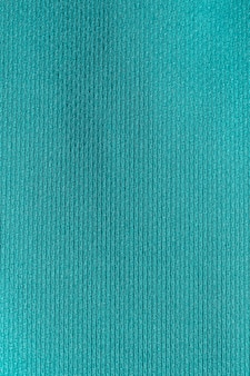 Priorità bassa di struttura del poliestere panno tessuto verde.