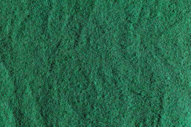Tessuto verde panno poliestere texture e sfondo tessile.