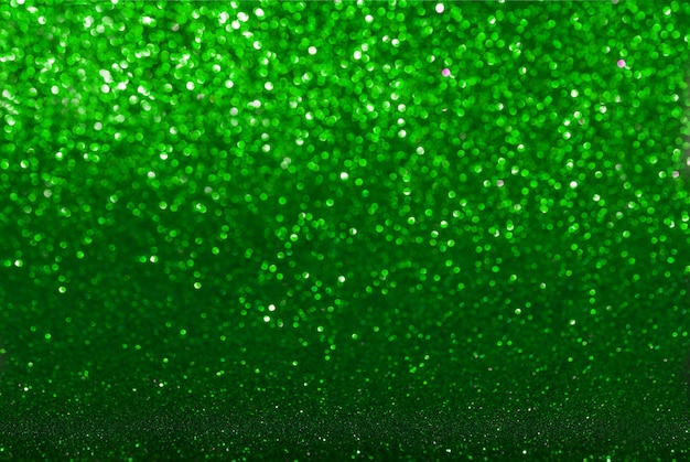 Sfondo texture glitter verde. messa a fuoco selettiva smeraldo scuro.