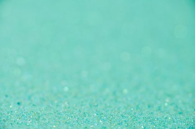 Trama di scintillio verde. anno nuovo o sfondo di natale per biglietto di auguri. celebrazione di san valentino. design scintillante brillante per la decorazione festiva: matrimonio, festa o festa di anniversario.