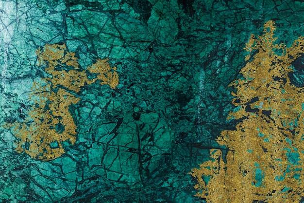 Sfondo astratto marmo verde e oro