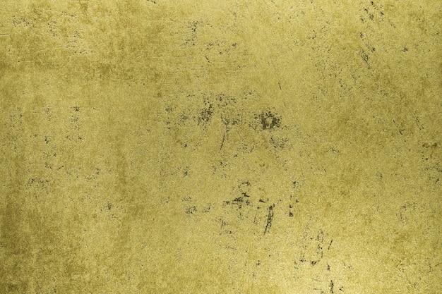 Superficie astratta dorata verde con texture di sfondo grunge verniciato.