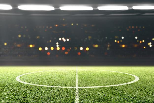 Erba verde e tribuna con luci sfocate