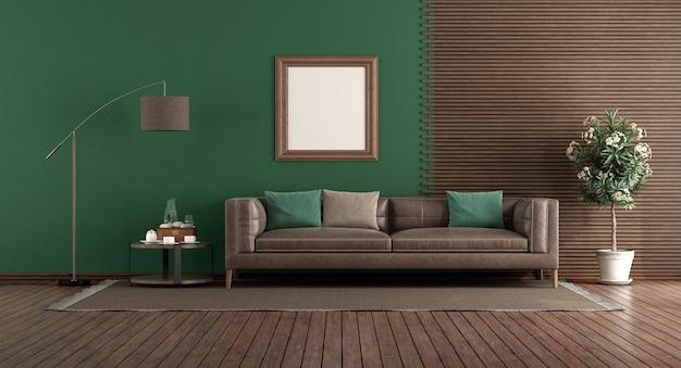 Soggiorno verde con divano in pelle davanti a un pannello di legno