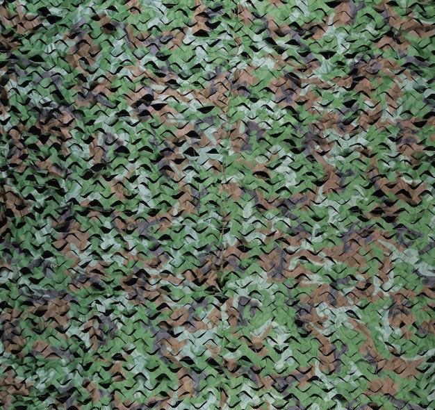 Sfondo verde mimetico militare con schizzi