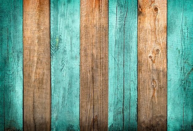 Sfondo di assi con texture legno verde e naturale con vignettatura delicata