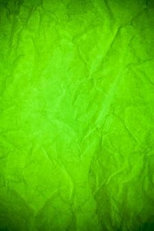 Fondo di struttura sgualcito di carta verde.