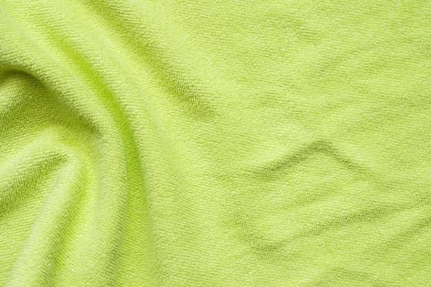 Fondo verde della superficie di struttura del tessuto dell'asciugamano