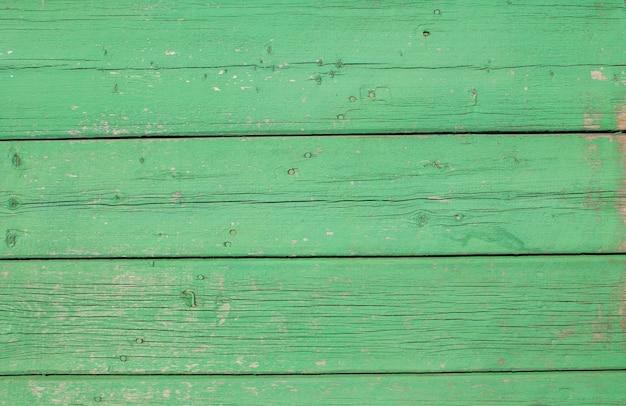 Tavola di legno verde sfondo vista dall'alto pannello di tavola di legno