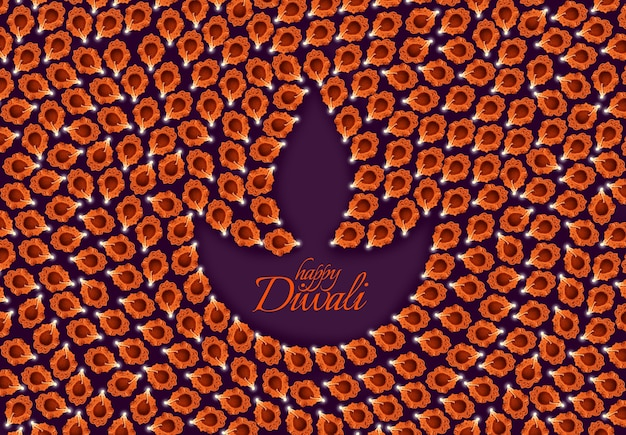 Biglietto di auguri che mostra la vista dall'alto di molte lampade a olio di argilla illuminate o panti che formano la forma di diya con testo happy diwali
