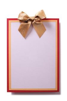 Biglietto di auguri fiocco oro decorazione vista frontale piatta verticale