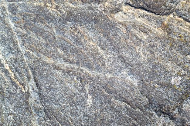 Struttura di pietra grigia, nera e bianca. superficie ruvida del granito, priorità bassa della parete di pietra minerale naturale
