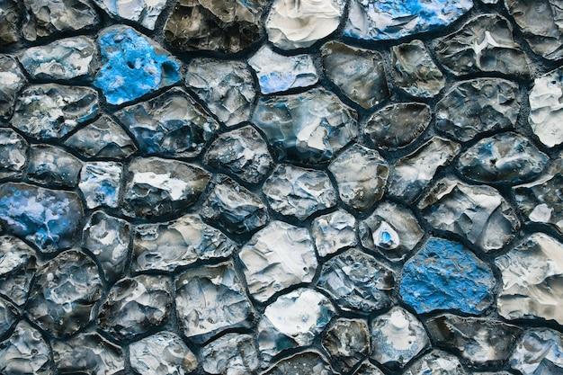 Muro di pietra grigio e blu del grunge