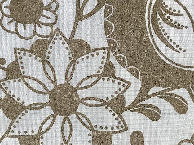 Fiori grigi e marroni su tessuto, motivo in tessuto, motivo senza cuciture, materiale, tessuto, sfondo grigio. colori alla moda alla moda. spazio alla tua creatività. posto per un'iscrizione o un logo