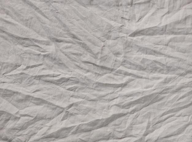 Sfondo di tessuto di lino stropicciato di colore grigio, vista dall'alto