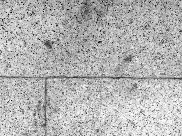Pavimento in materiale di cemento di pietra di colore grigio e vecchia struttura e vista dall'alto per lo sfondo.