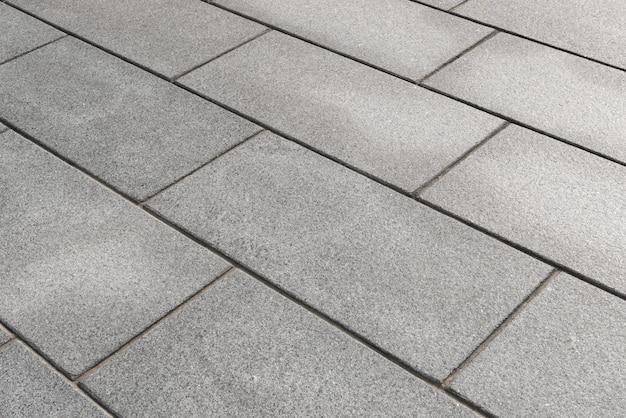 Sfondo grigio pavimentazione in blocchi di cemento. concetti di costruzione.