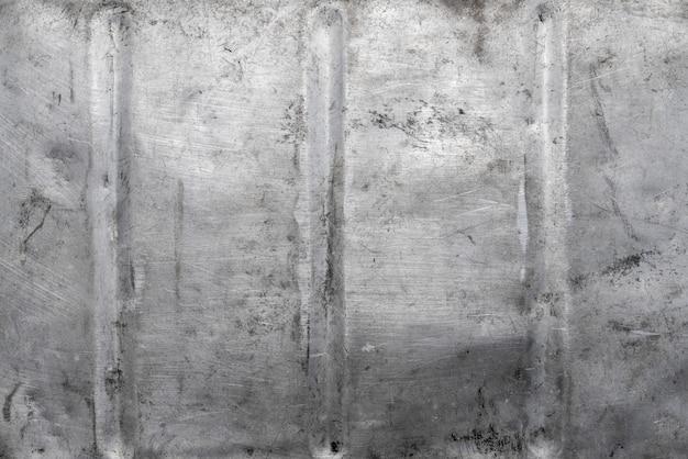 Muro di cemento grigio con struttura in cemento per lo sfondo. il vecchio muro di cemento texture grigio sporco con sfondo nero il design di colore grigio e argento astratto è chiaro con sfondo bianco