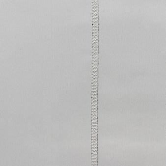 Tessuto di tessuto grigio con cucitura