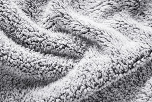 Priorità bassa strutturata del tessuto della pelliccia grigia