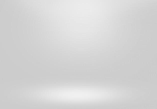 Sfondo grigio sfumato. vuota stanza luce interna per la tua creatività e mostra i tuoi prodotti.