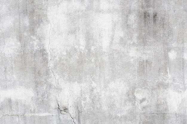 Mortaio grigio del grunge con struttura in bianco e nero del particolare della priorità bassa della parete delle crepe