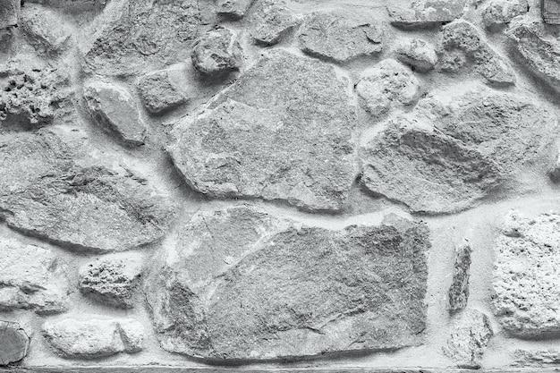 Trama di sfondo grigio muro di pietra del grunge