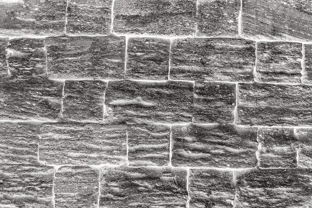 Struttura della parete di pietra grigia del grunge
