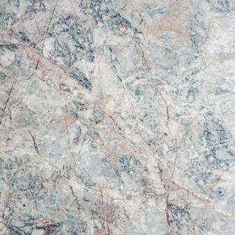 Parete di pietra grigia del marmo o fondo di struttura del pavimento